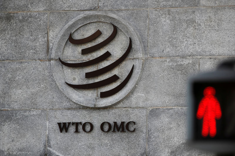 © Reuters. FILE PHOTO: Logo is pictured outside the WTO headquarters in Geneva