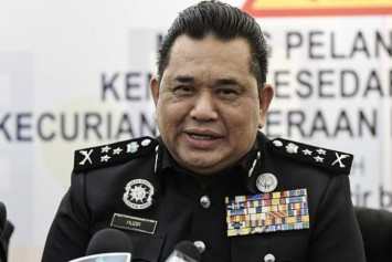 Malaysia police haul in state rep over sex video