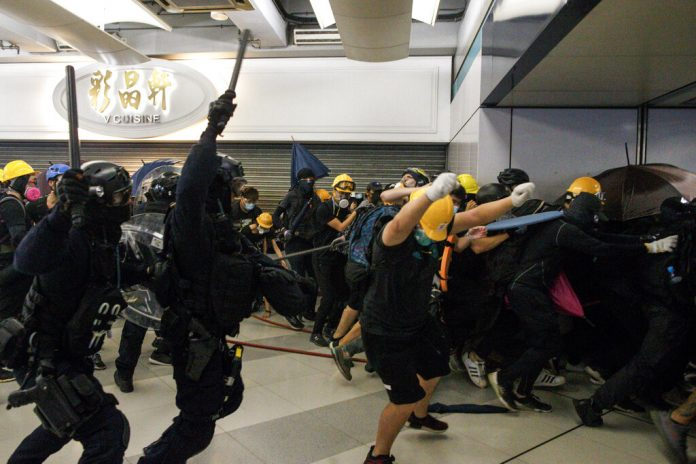 The Latest: Hong Kong rally protests police use of force