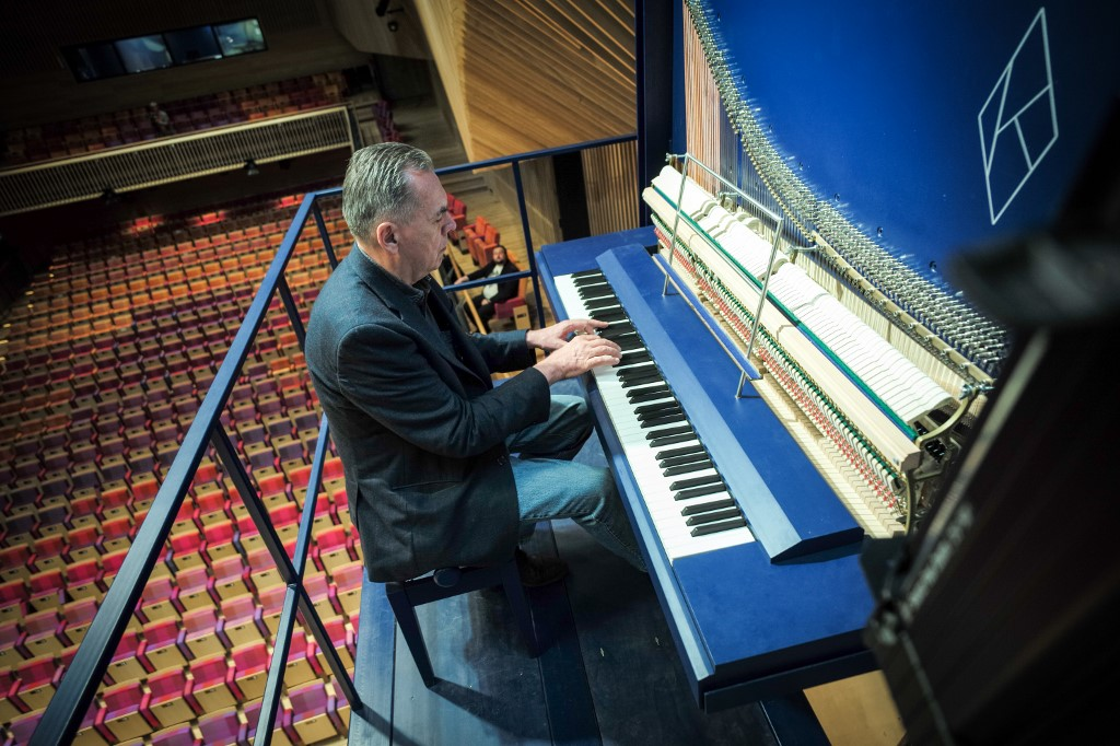 Piano constructor and builder David Klavins plays his new creation, the M470i vertical concert grand piano, with a height of 4,70 metres, at the new Lativa concert hall in Ventspils, Latvia, on July 23, 2019. — AFP pic