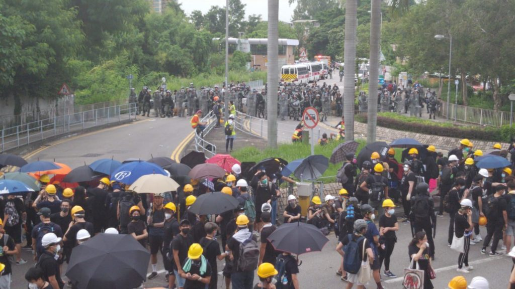 Protesters face off with riot police at an unsanctioned rally in Yuen Long today. Photo by Vicky Wong.