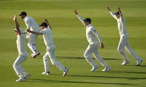 England slip cordon left to right of Joe Denly; Jonny Bairstow; Rory Burns; Jason Roy and Joe Root celebrate after Stuart Broad had bowled Andy McBrine.