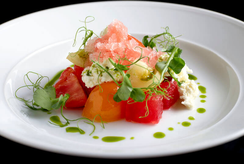 Vine tomatoes and mixed melon. Photo: Cook & Tras