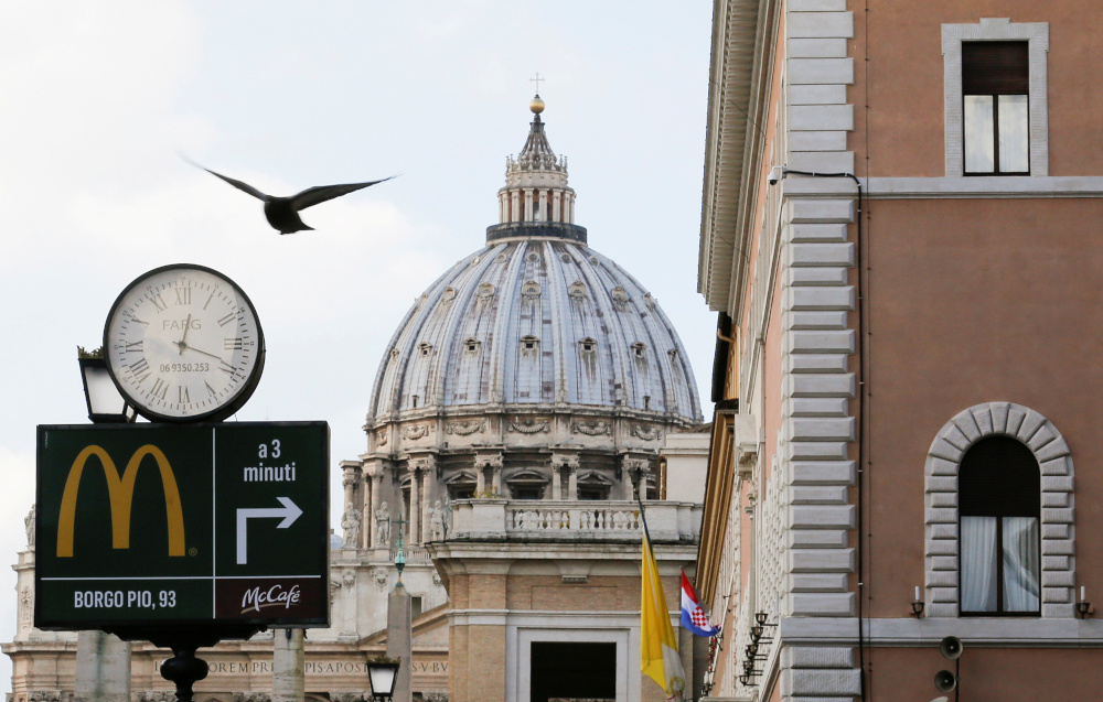 A McDonald's sign is seen on Via della Conciliazione street in Rome in front of Vatican City's St Peter's Square, January 3, 2017. — Reuters pic