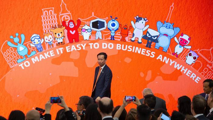 Mandatory Credit: Photo by JEROME FAVRE/EPA-EFE/Shutterstock (10485229e) Daniel Zhang, Chief Executive Officer of Alibaba Group, attends the company's stock trading debut at the headquarters of the Hong Kong Exchanges and Clearing in Hong Kong, China, 26 November 2019. Alibaba Group, operator of the Taobao and Tmall online trading platforms, raised 101.2 billion Hong Kong dollar (12.9 billion US doillar) by selling 575 million new shares to investors. Stock listing of ALibaba Group in Hong Kong, China - 26 Nov 2019