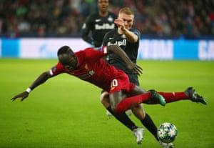 Sadio Mane goes down under a challenge from Salzburg's Rasmus Kristensen.