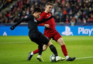 Salzburg's Hwang Hee-chan takes on Jordan Henderson.
