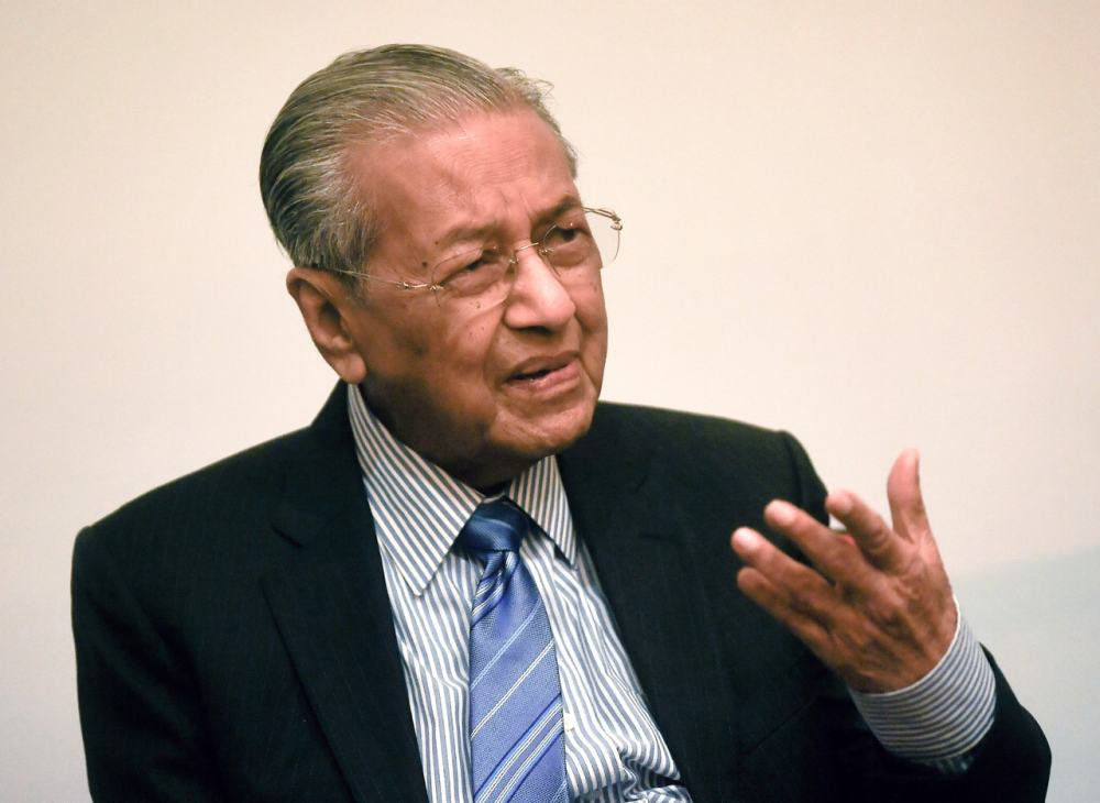 Prime Minister Tun Dr Mahathir Mohamad said the Cabinet would determine whether PPSMI will be reintroduced or decide to maintain teaching of the two subjects in the national language. ― Bernama pic