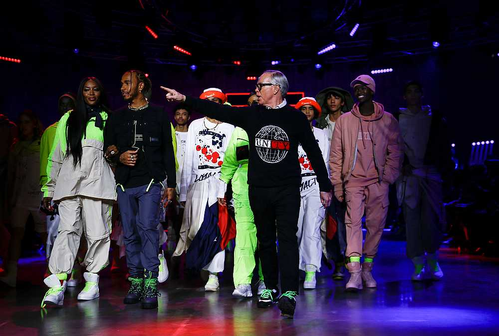 Designer Tommy Hilfiger is joined by Lewis Hamilton and models following his 'TOMMYNOW Spring 2020' show during London Fashion Week in London February 16, 2020. — Reuters pic