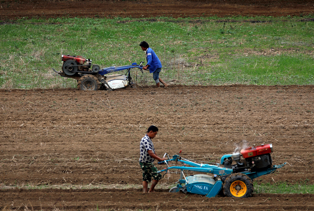 Farmers use tractors to plough the field as they wait for the monsoon rains to harvest rice in Lalitpur, Nepal June 26, 2019. — Reuters pic