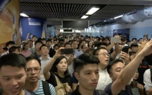 Passengers waiting on the platform of Admiralty MTR after protesters stage a guerrilla protest. Screengrab via Facebook video/RTHK.