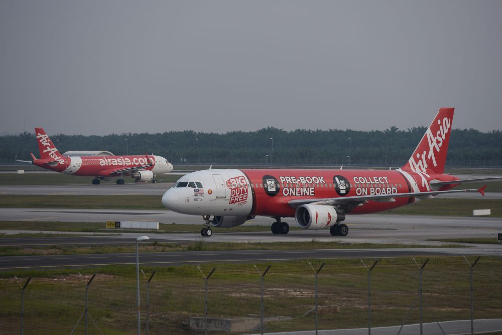 AirAsia planes are pictured on the tarmac of the Kuala Lumpur International Airport in Sepang August 20, 2019. — Picture by Miera Zulyana
