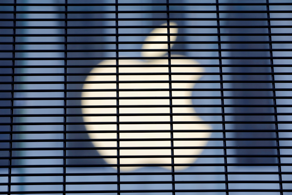 The Apple logo is seen through a security fence erected around the Apple Fifth Avenue store in Manhattan, New York City, US, November 5, 2020. — Reuters pic