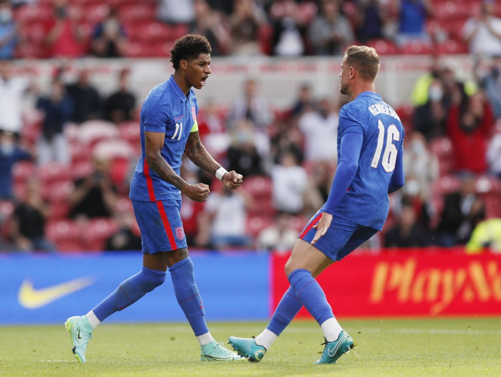 England's Marcus Rashford celebrates scoring their first goal against Romania with Jordan Henderson Riverside Stadium, Middlesbrough June 6, 2021. — Reuters pic