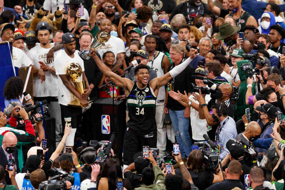 Milwaukee Bucks forward Giannis Antetokounmpo (34) celebrates with the NBA Finals MVP Trophy following the game against the Phoenix Suns following game six of the 2021 NBA Finals at Fiserv Forum. — Jeff Hanisch-USA TODAY Sports pic via Reuters
