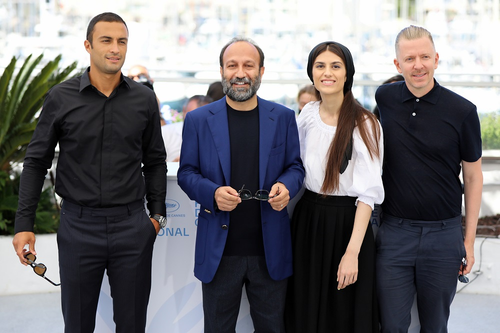 Director Asghar Farhadi, cast members Amir Jadidi and Sarina Farhadi and producer Alexandre Mallet-Guy pose for a group picture during the photocall for the film 'A Hero' (Ghahreman) in Cannes July 14, 2021. — Reuters pic