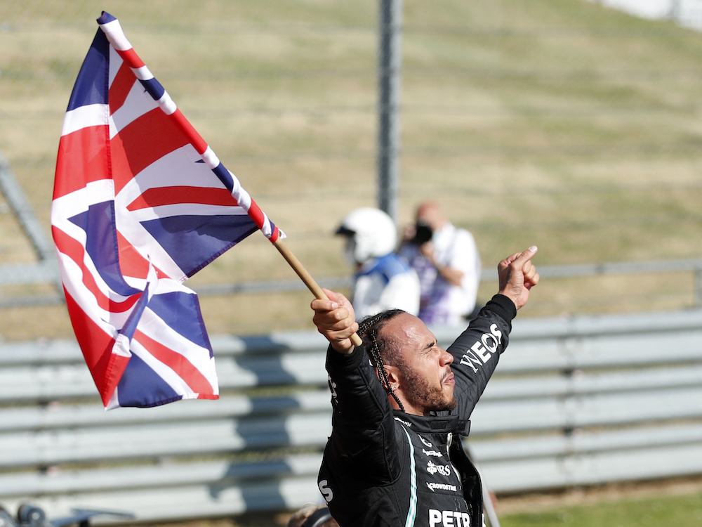 Mercedes' Lewis Hamilton celebrates winning the British Grand Prix for the eight consecutive time at the Silverstone Circuit, Silverstone, Britain July 18, 2021. — Reuters pic