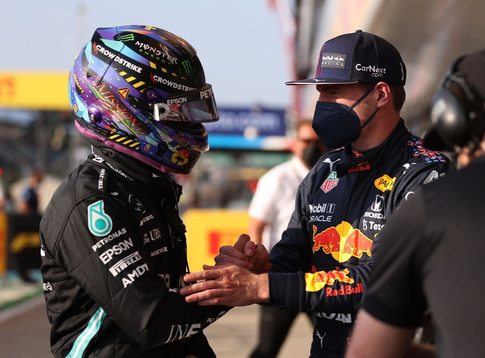 Mercedes' Lewis Hamilton shakes hands with Red Bull's Max Verstappen at the Silverstone Circuit July 16, 2021. — Reuters pic