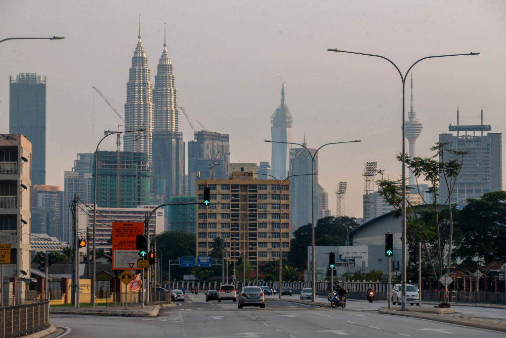 As the pandemic has caused a significant rise in Malaysia's general government debt, in line with its rating peers, Fitch forecast the debt to reach 78.1 per cent of GDP in 2021, from a pre-pandemic level of 65.2 per cent in 2019. — Picture by Firdaus Latif