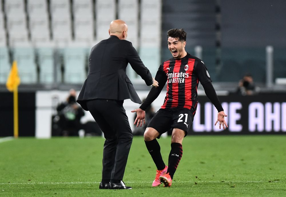 AC Milan's Brahim Diaz celebrates scoring their first goal against Juventus with coach Stefano Pioli at the Allianz Stadium in Turin May 9, 2021. — Reuters pic