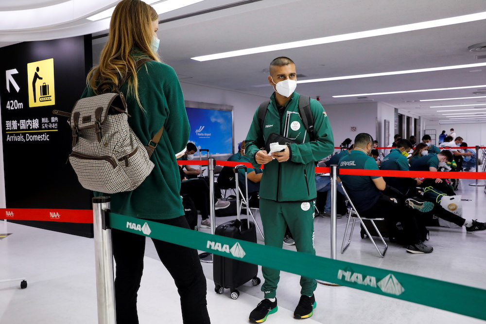 Members of South Africa team wait to be tested for a coronavirus disease (Covid-19) at Narita international airport ahead of Tokyo 2020 Olympic Games in Narita, east of Tokyo, Japan July 17, 2021. — Reuters pic