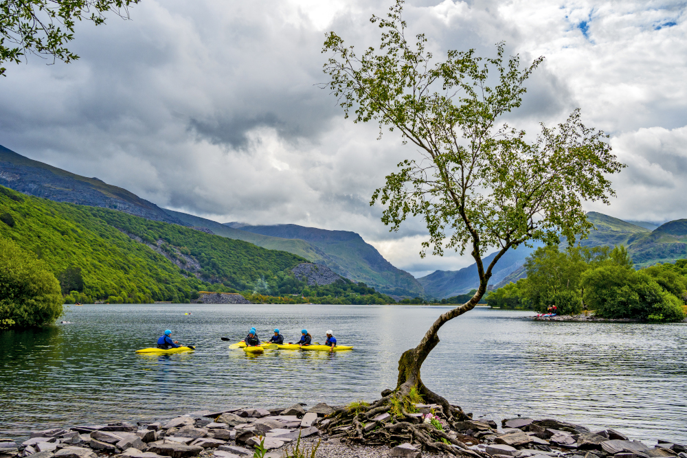 Canoers on Llyn Padarn lake in Snowdonia, Gwynedd July 28, 2021. Unesco today added the Slate Landscape of Northwest Wales in the county of Gwynedd to its list of world heritage sites. — PA Images pic via Reuters