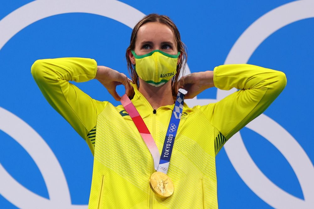 Emma McKeon of Australia with her gold medal after the women's 50m freestyle at the Tokyo Aquatics Centre August 1, 2021. — Reuters pic
