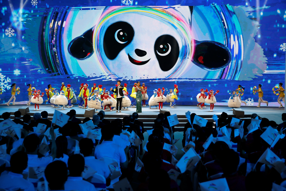 Singers perform on stage at a ceremony unveiling the slogan for Beijing 2022 Winter Olympics, in Beijing, China September 17, 2021. — Reuters pic