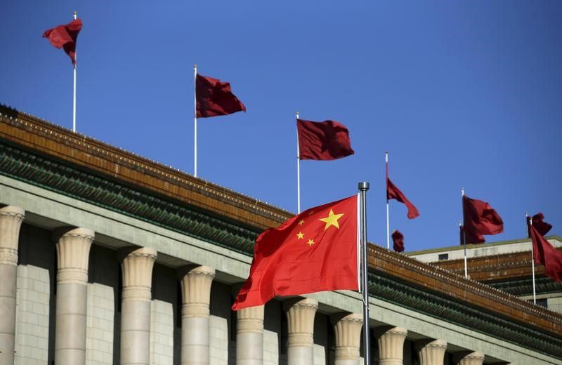 Chinese flag waves in front of the Great Hall of the People in Beijing, China, October 29, 2015. — Reuters pic