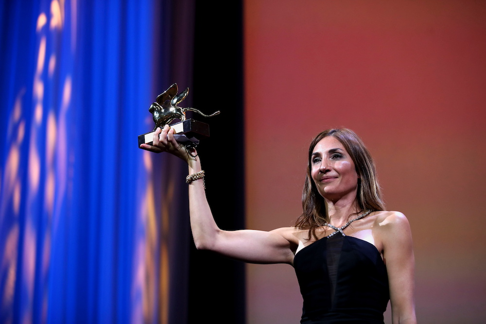 Director Audrey Diwan receives the Golden Lion award for Best Film in Venice September 11, 2021. — Reuters pic