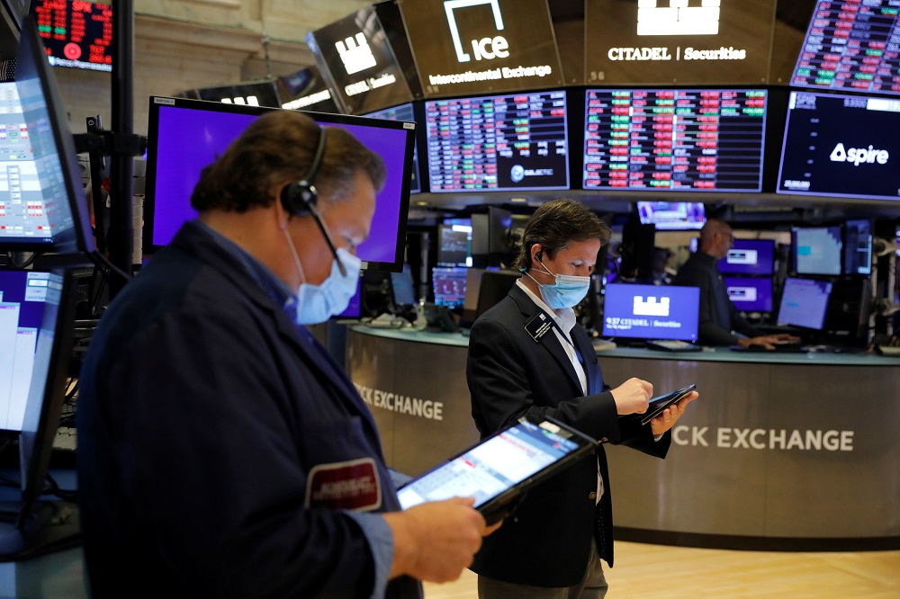 SCI's world stocks benchmark fell 0.33 per cent, and all 11 major sectors in the S&P 500 ended the session lower, with energy and financials falling the most. — Reuters pic