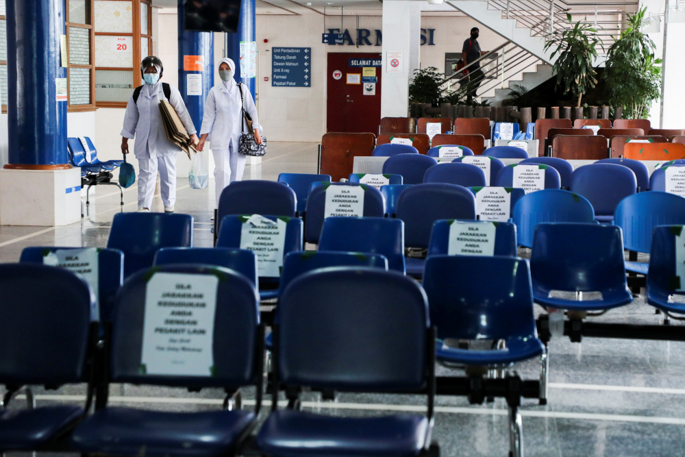 Health workers walk past empty seats at Sultanah Maliha Hospital, amid the coronavirus disease outbreak in Langkawi, Malaysia September 15, 2021. — Reuters pic