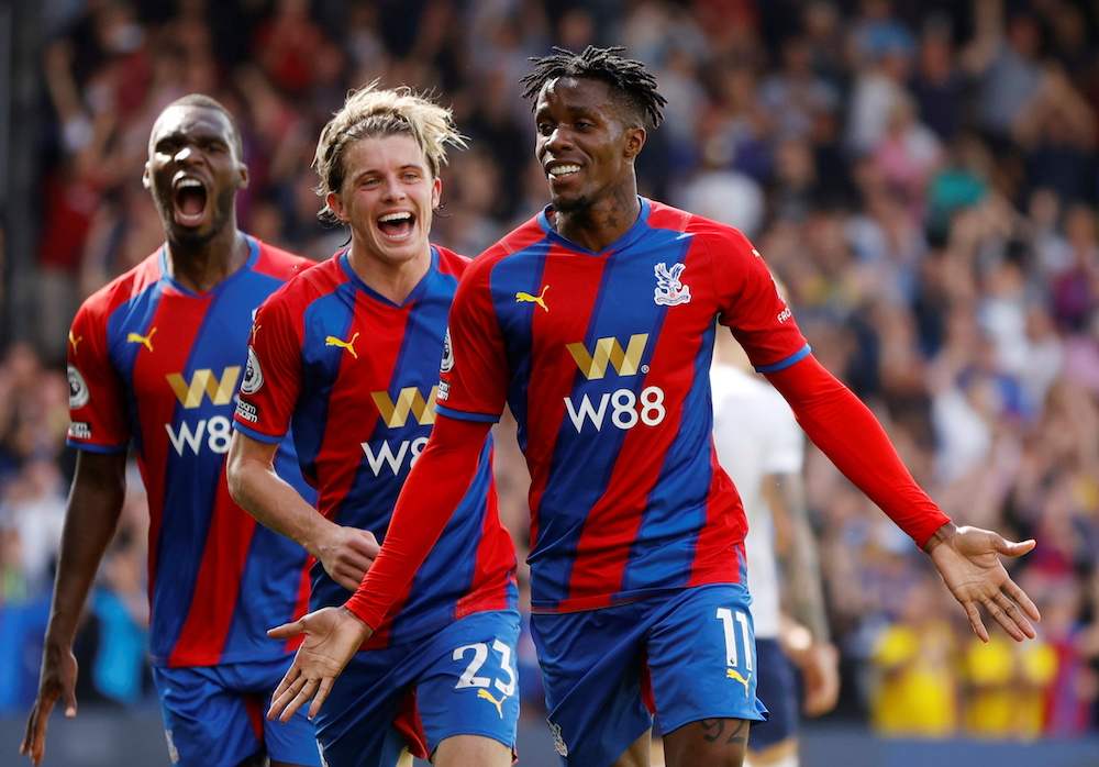 Crystal Palace's Wilfried Zaha celebrates scoring their first goal with Conor Gallagher and Christian Benteke during their match against Tottenham Hotspur at Selhurst Park in London, September 11, 2021. — Reuters pic