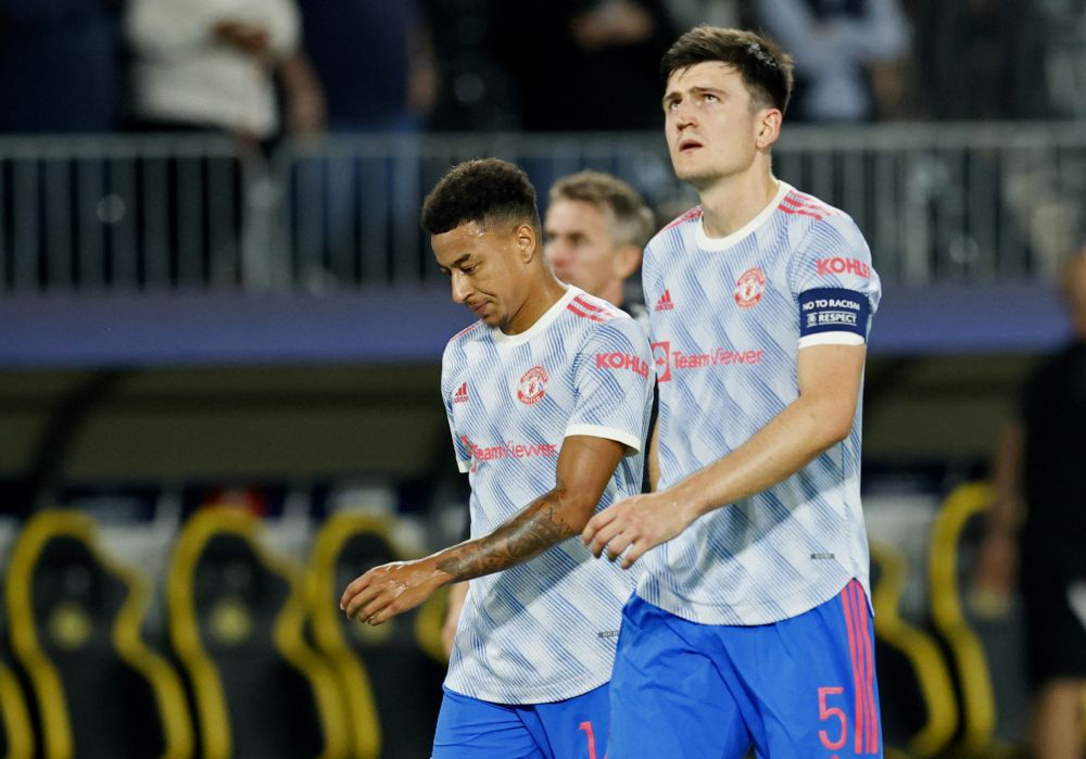 Manchester United's Jesse Lingard and Harry Maguire look dejected after the match against Young Boys at Stadion Wankdorf, Bern September 14, 2021. — Reuters pic