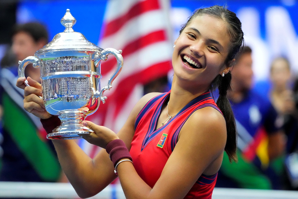 Emma Raducanu of Great Britain celebrates with the championship trophy in the women's singles final of the 2021 US Open tennis tournament. — Reuters pic