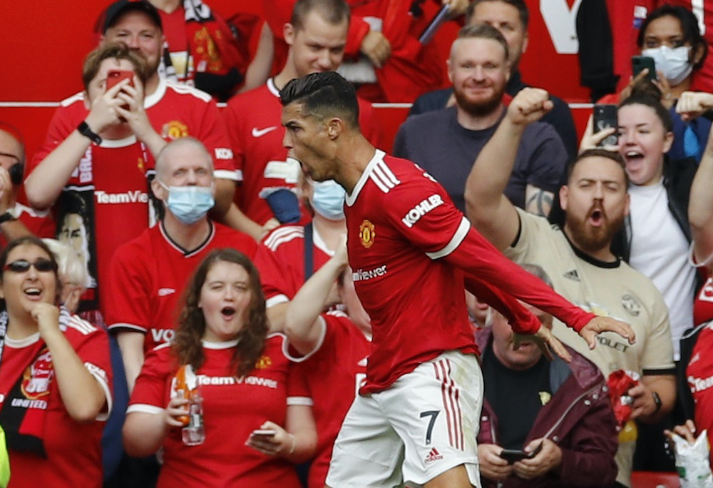 Manchester United's Cristiano Ronaldo celebrates scoring their first goal during the match against Newcastle United at the Old Trafford in Manchester, September 11, 2021. — Reuters pic