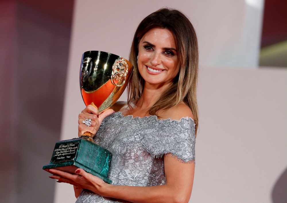 Actor Penelope Cruz poses with her Coppa Volpi Award for Best Actress, Venice September 11, 2021. — Reuters pic
