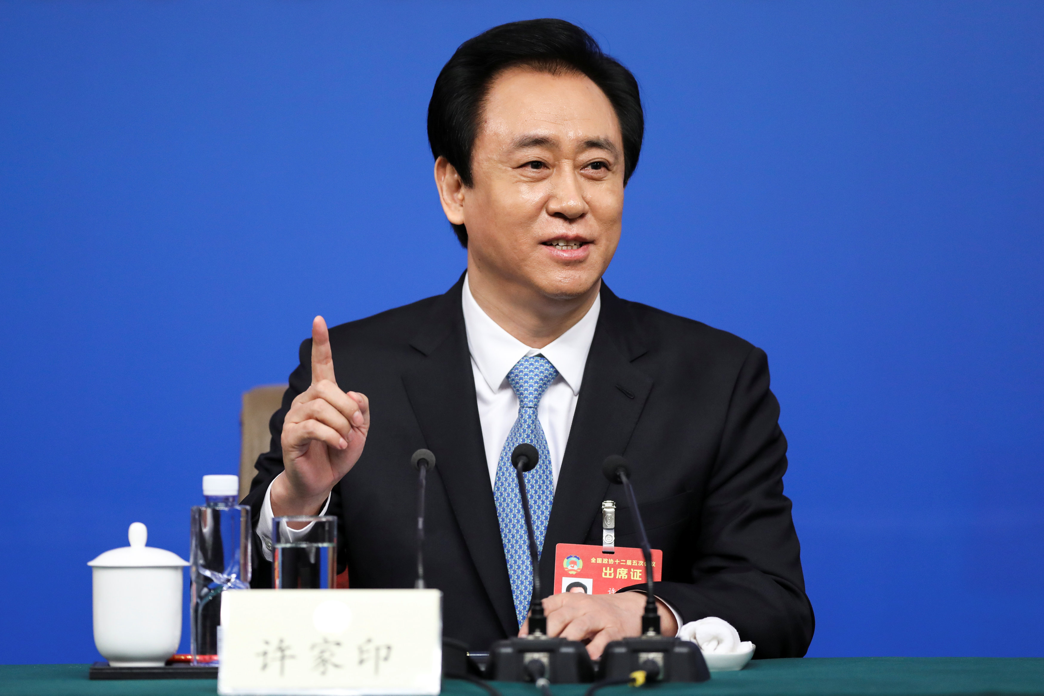 Evergrande Group chairman Xu Jiayin gestures during a press conference for the Fifth Session of the 12th CPPCC National Committee in Beijing, China March 9, 2017. — Reuters pic