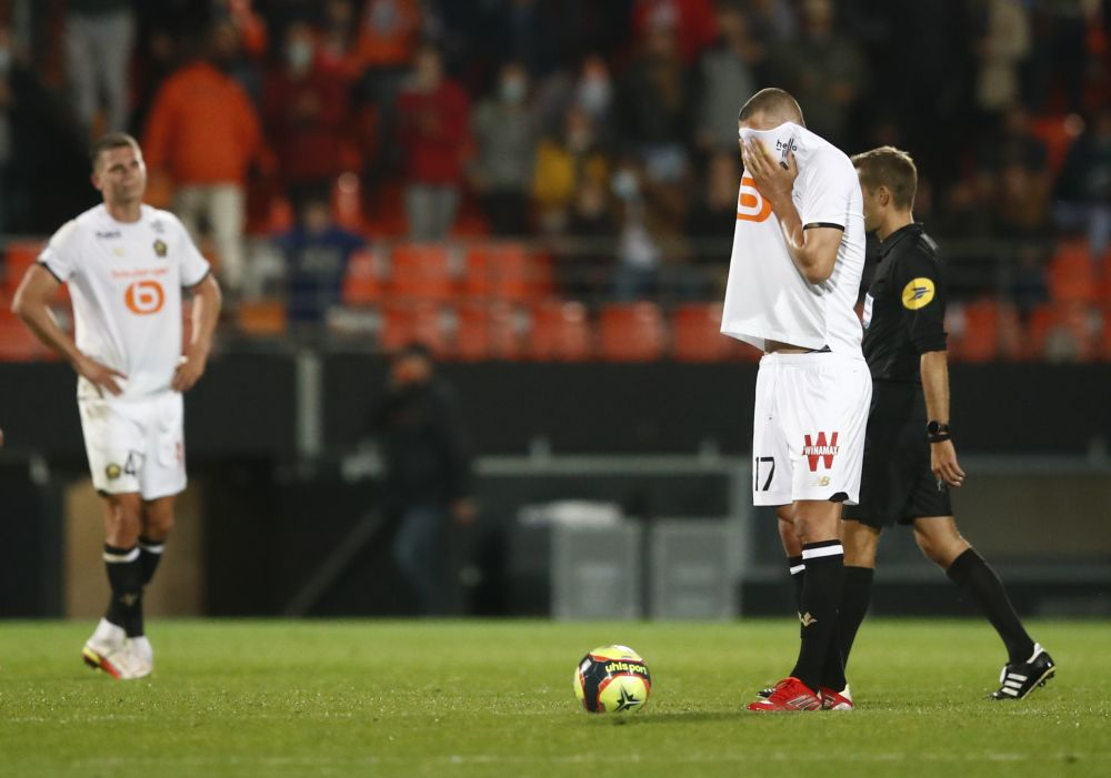 Lille's Burak Yilmaz looks dejected after Lorient's Terem Moffi scored their second goal at Stade du Moustoir, Lorient September 10, 2021. — Reuters pic