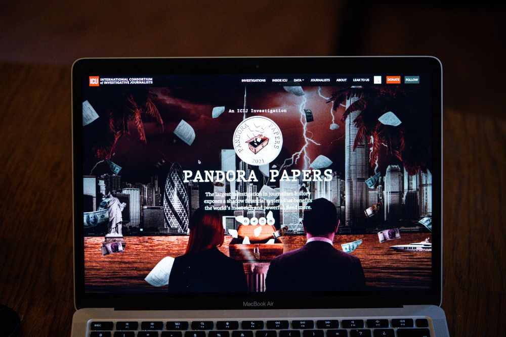 An ilustration of a laptop showing the website of the International Consortium of Investigative Journalists with the presentation of the Pandora Papers in Paris October 4, 2021. — Reuters pic