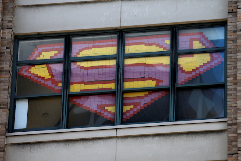 An image of the Superman Logo created with Post-it notes is seen in windows at 200 Hudson street in lower Manhattan, New York, May 18, 2016. — Reuters pic